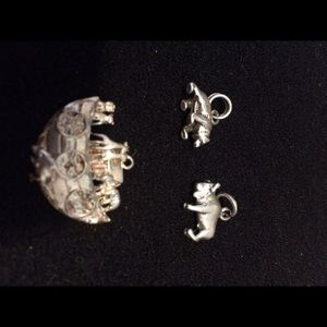 Three sterling silver charms